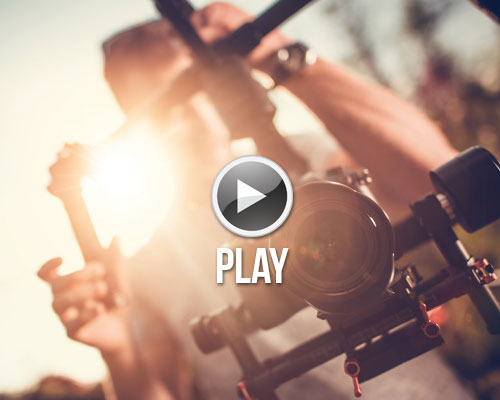 Showreel graphic of cameraman with a Camera and gimbal taken at sunset